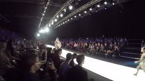 Out Of Focus Background Models Walk The Runway During Fashion
