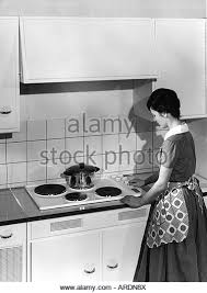 Household Kitchen Woman At The Stove 1950s 50s Cooking Pot