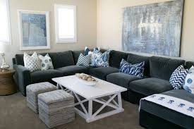 White And Blue Flag With Grey Couch Pillows