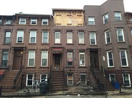 partial facade collapse at brownstone on jefferson avenue in bed