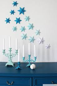 DIY 3D Paper Stars On The Wall For Christmas Via Dekotopia
