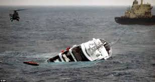 nadine yacht sinking plane crash going going sailors plucked to safety as boat sinks