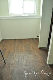 downstairs renovation progress and our wood look ceramic tile