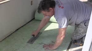 uncoupling membrane installation on concrete and plywood subfloor