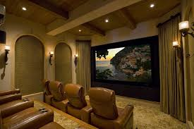 home theater with leather brown seats and traditional wall sconces