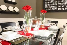 Romantic Dining Room Centerpiece With Red Flowers In Tall Glass Vases And White Table Runner