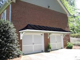 Metal Roof Portico Over Double Garage Doors. Designed And Built By ... Awning Mesh And Wooden Modern Metal Roof Ideas Single Alinium Retractable Conservatory Buy Arh Exterior Plan Hamptone 51 Oc Oakridge Modern Single House Design With Steel Mesh Awnings And Wooden Aegis Canopy Datum Commercial Architecture Mobile Home Carport Vernia Uber Decor 1662 Roof Patio Cover Designs Favored Standing Seam Awnings Alinum Prefinished Parasol S Photo Pixelmaricom Design Covers Superior Porch Black Metal Only Big Enough For Seating