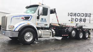 Roll Off Truck For Sale In Connecticut Roll Off Truck Driver Greg Brown Of Austin Texas One The New Earthwise Demolition Rollofftruck Image Proview Jwh Hydraulics Ltd Waste Management Equipment Rolloffs Rollofftruckboombeingraisedjpg Rolloff Truck And Dumpster Olympus Recycling New 2019 Intertional Hx Rolloff Truck For Sale In Ny 1028 How To Operate A Stinger Tail Youtube 2006 Sterling W71883 Parris Sales Garbage Trucks For Sale In California 24 Listings Page 1 Stock Photos Royalty Free Images Trailer System Customers Call Ezrolloff Beast