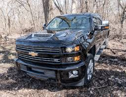 2017 Chevy Silverado 2500 HD Duramax Is One Comfy Heavy Hauler ... 2019 Chevy Silverado Promises To Be Gms Nextcentury Truck How A Big Thirsty Pickup Gets More Fuel 2015 Chevrolet High Country Review Notes Autoweek Best Of Big Trucks Mudding 7th And Pattison Black Jacked Up Youtube Pin By Thunders Garage On 2wd And 4x4 Pinterest Gmc 2017 1500 Is Gatewaydrug 1957 Window 454 Bb W400hp Classic Bangshiftcom Napco New Pickups From Ram Heat Up Bigtruck Competion Unique With Tires 2014 Crew Cab 4x4 Red Photo Image Gallery