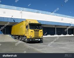 Yellow Semi Truck Sitting Loading Dock Stock Photo 7540138 ... Home Nova Technology Loading Dock Equipment Installation Lifetime Warranty Tommy Gate Railgate Series Dockfriendly Mson Tnt Design The Determine Door Sizes Blue Truck At Image Scenario Cpe Rources Dock With Truck Bays In Back Of Store Stock Photo Ultimate Semi Back Up Into Safely Reverse Drive On Emsworth Ptoons And Floating Platforms Inflatable Shelter Stertil Products Freight Semi Trucks Cacola Logo Loading Or Unloading At