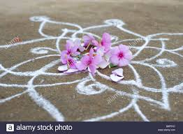 Pink Flowers On Simple Rangoli Design Outside A Indian Rural ... Rangoli Designs Free Hand Images 9 Geometric How To Put Simple Rangoli Designs For Home Freehand Simple Atoz Mehandi Cooking Top 25 New Kundan Floor Design Collection Flower Collection6 23 Best Easy Diwali 2017 Happy Year 2018 Pooja Room And 15 Beautiful And For Maqshine With Flowers Petals Floral Pink On Design Outside A Indian Rural 50 Special Wallpapers