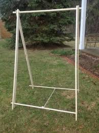 Portable Clothes Rack for Events and Camping Wood Garment Rack