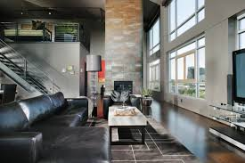 Spacious Living Room Featuring Myriad Textures And Tones Including Black Leather Sectional With Chaise Lounge