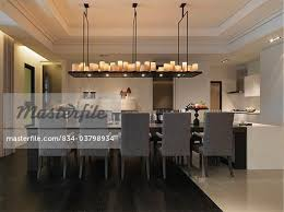Long Dining Room Table With Candle Chandelier