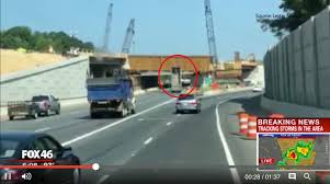Dump Truck Driver Doesn't Lower Dump Bed, Strikes Bridge