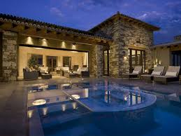 Comfortable Lounge On Tiled Floor Beside Cool Swimming Pool Designs Illuminated By Outdoor Wall Lamp