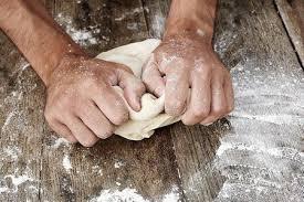 Man Kneading Bread Dough