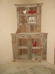 Rustic Wood Corner Shelf With Narrow And Wide Section Plus Two Swing Door At Cream Wall Theme