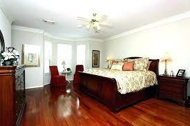 Grey Walls With Wood Floors Bedroom