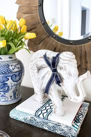 Decorative Elephant On Stack Of Fabric Wrapped Books