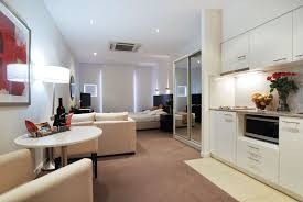 ApartmentsSmall Minimalist Apartment Decor Interior With Brown Fabric Carpet And White Painted Wall Also