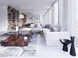 elegante und luxuriöse licht öffnen wohn und esszimmer mit weißen wänden hellen holzböden und große bücherregale stockfoto und mehr bilder