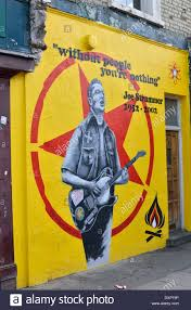 mural painting of the rock musician joe strummer notting hill