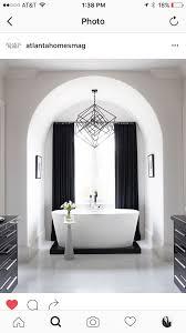 circa lighting cubist medium chandelier over bathroom tub