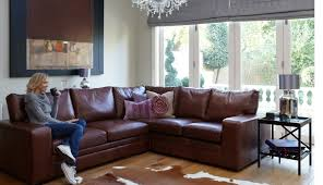 Rustic Purple Leather Sofa For Traditional Living Room Design With Animal Inspired Rug And Black Side Table