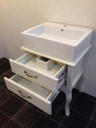 Shabby Chic Bathroom Vanity by Furniture Carved White Wooden Shabby Bathroom Vanity With Round
