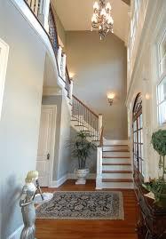 Interior Black Cushions On Whte Sectional Sofa Narrow Hallway Wall Decor Red Pattern Floor Rug Bluehigh