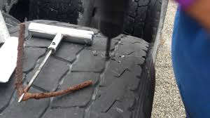 How To Repair A Nail Hole In A Tire With A Plug On Semi Truck, Big ... Semi Truck Tire Changer Whosale Suppliers Aliba And Trailer Repair Near Me How To A Nail Hole In Tire With Plug On Semi Truck Big Repair 2 Fding Leak Tighten Valve Stem Youtube Blown Tires Are Serious Highway Hazard Roadtrek Blog Tools And Trucks Busescommercial Sealant Medic Commercial Maintenance Kit For Medium Heavy Duty 30 Cords Aw Direct