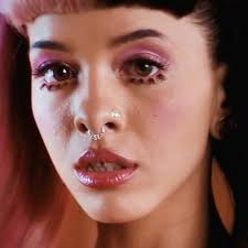 Leave a ment Melanie Martinez has pink eye makeup