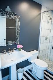black and white bathroom with large marble hex floor tiles