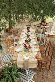 Rustic Country Wedding Reception Decorations With Colorful Flowers On Long Wooden Table Also Small Chairs