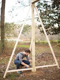 How To Build A Modern A-Frame Swing Set | HGTV Freestanding Aframe Swing Set 8 Steps With Pictures He Got Bored With His Backyard So Tore It Down And Pergola Canopy Fniture Free Pergola Plans You Can Diy How To Build A Arbor Howtos Diy Nearly Handmade Building Stairs For The Club House To A Fort Outdoor Goods Simpleeasycheap Porbench 2x4s Youtube Discovery Weston Cedar Walmartcom Combination Playhouse And Climbing Wall How Porch Made From Pallets Simple Ideas All Home For Tim Remodelaholic Tutorial An Amazing Firepit