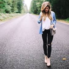 Brighton Keller Wearing Chambray Shirt And Black Distressed Jeans