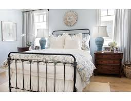 The Black Iron Bed Is Perfect Piece In This Blue And White Bedroom