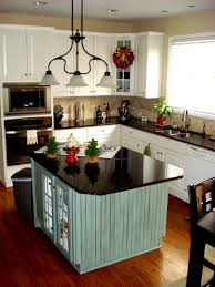 Kitchen Island Design With Pendant Light And Black Table