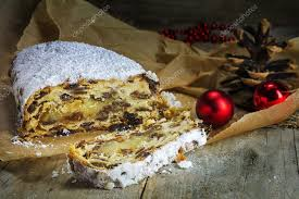 Christmas stollen traditional German cake in brown paper on rus