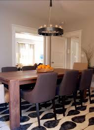 barn chandelier casts rustic light onto dining room table blog