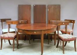 Empire Style Circular Mahogany Dining Table And A Set Of Twelve Chairs With Upholstered