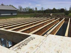 After The Superior Foundation Was Set This Week Framing Crew Is Laying TG Sub Floor Sheathing OSB Dry Guard
