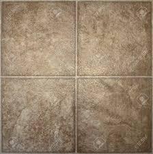 Four Squares Of Brown Textured Linoleum Floor Tile Stock Photo