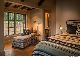 Mid Sized Mountain Style Guest Bedroom Photo In Other With Light Hardwood Floors And Beige Walls
