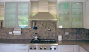 frosted glass or clear glass cabinets with back lighting for