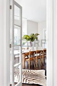 Beautiful Wooden Dining Table In Drawing Room Of Luxury House Showing The Entrance With Door