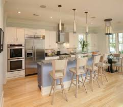 Bright Natural Wood And White Cabinetry Informs The Look Of This Broad Kitchen With Speckled