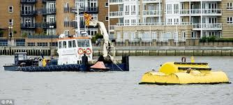 Tug Boat Sinks by River Thames Closed After Tugboat Capsizes And Crew Member Missing