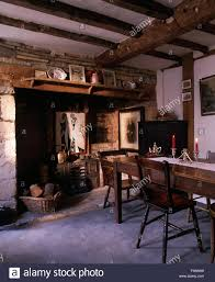 Inglenook Fireplace In Old Fashioned Victorian Style Dining Room With Antique Furniture